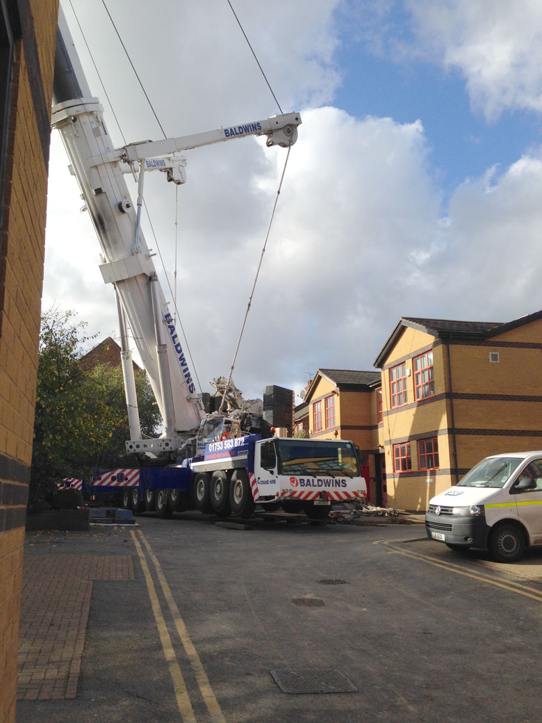 Crane assisting steel piling installation