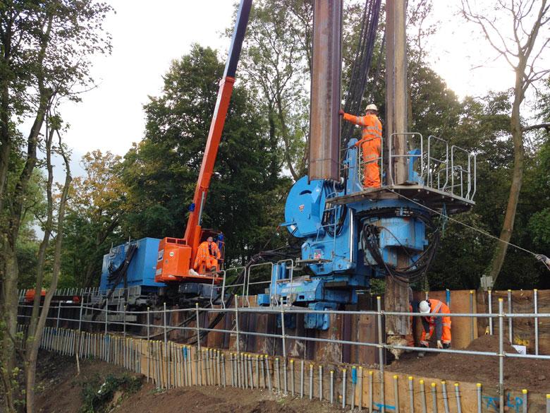Giken Supercrush pile driver installing piling next to Metropolitan Line railway at Chesham
