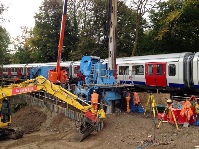 Giken Supercrush vibration-free pile driver on Metropolitan Line railway at Chesham