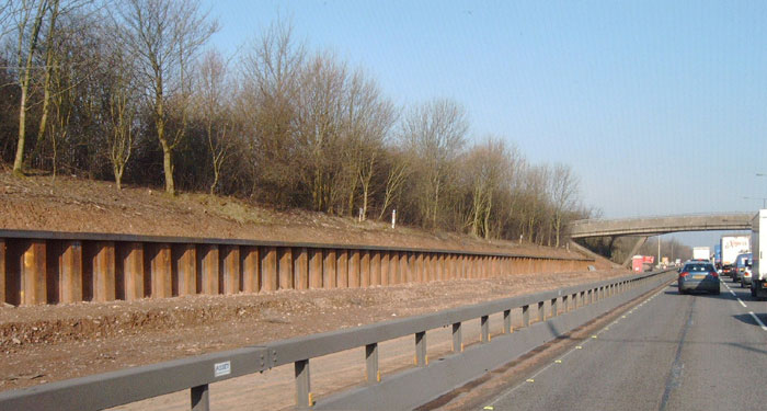 Steel piling retaining wall by motorway