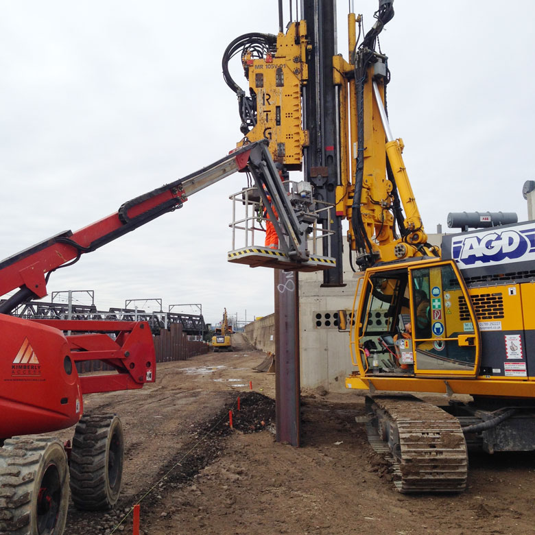 Telescopic leader rig inserting piling next to Old Oak Common Approach railway